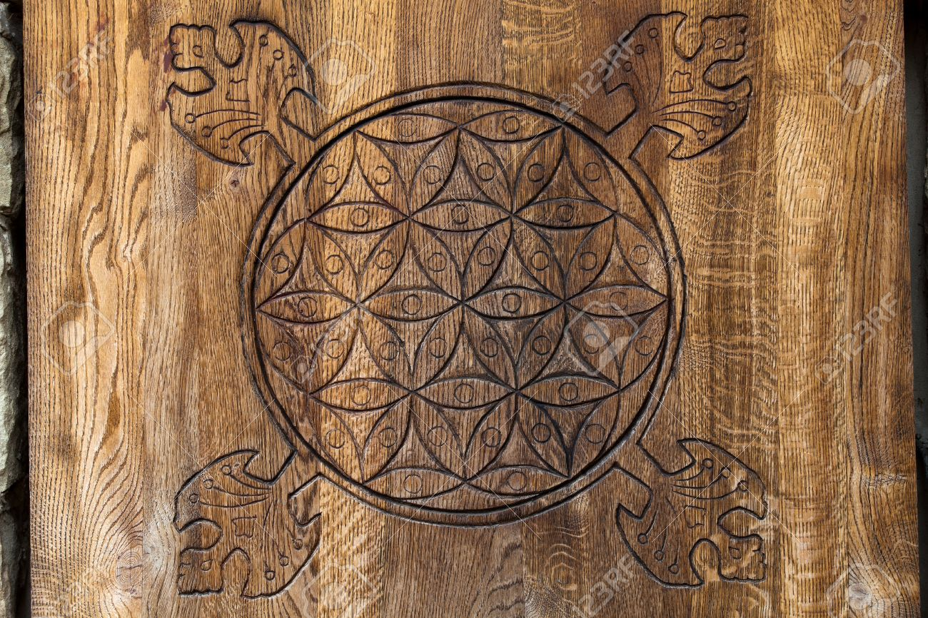 Wooden Flower of Life.  The Flower of life is an ancient symbol of Sacred Geometry and represents the fundamental order of creation. Stock Photo - 25681328