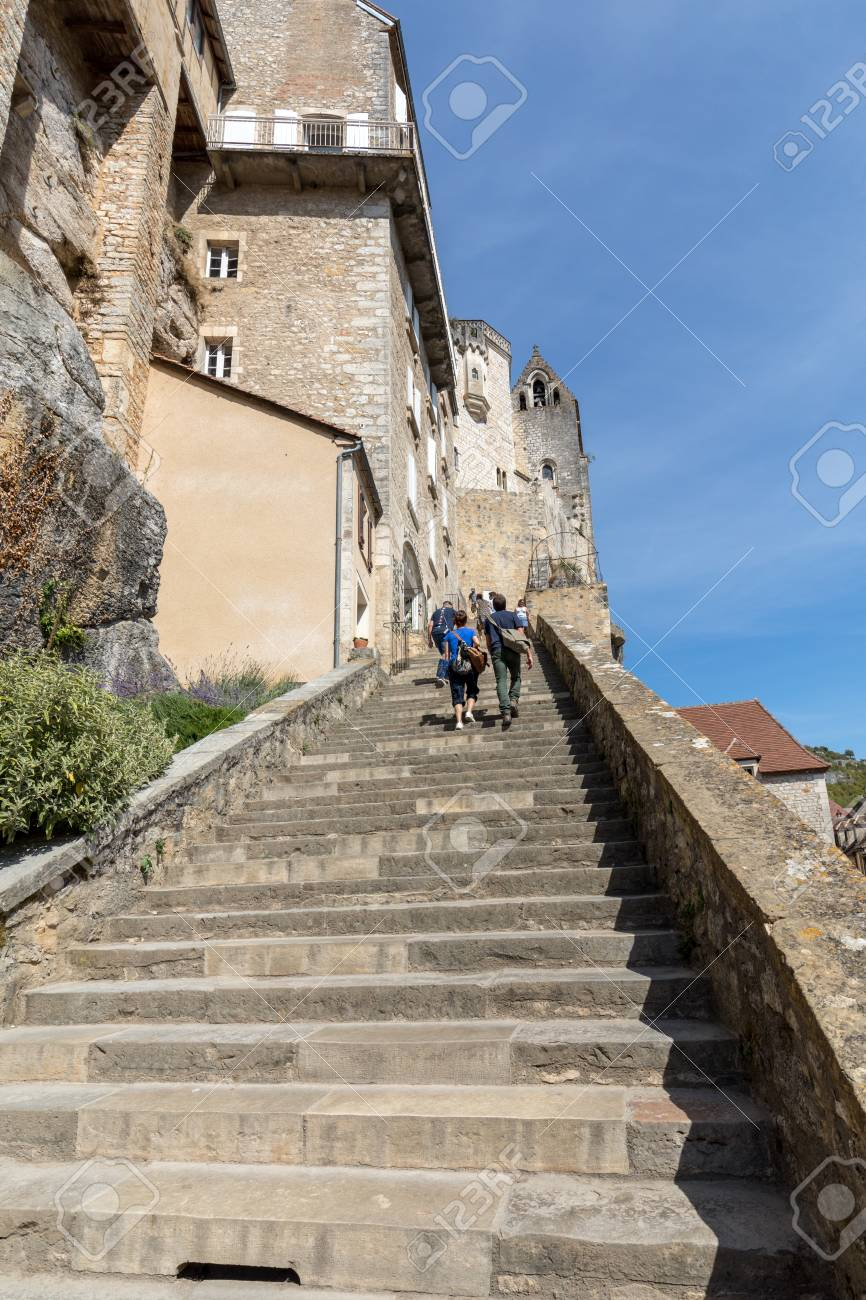 Rocamadour, France - September 3, 2018: People on steep steps