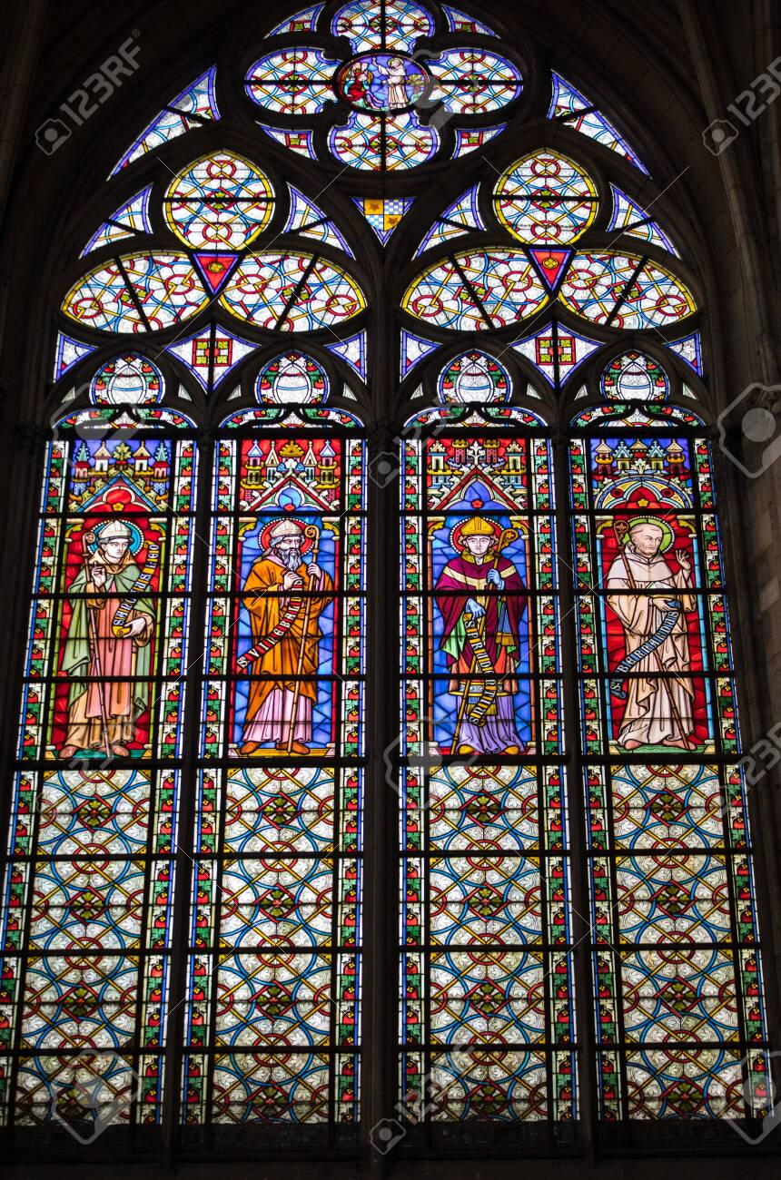 Troyes, France - August 31, 2018: Colorful stained glass windows in Basilique Saint-Urbain, 13th century gothic church in Troyes, France - 135344885