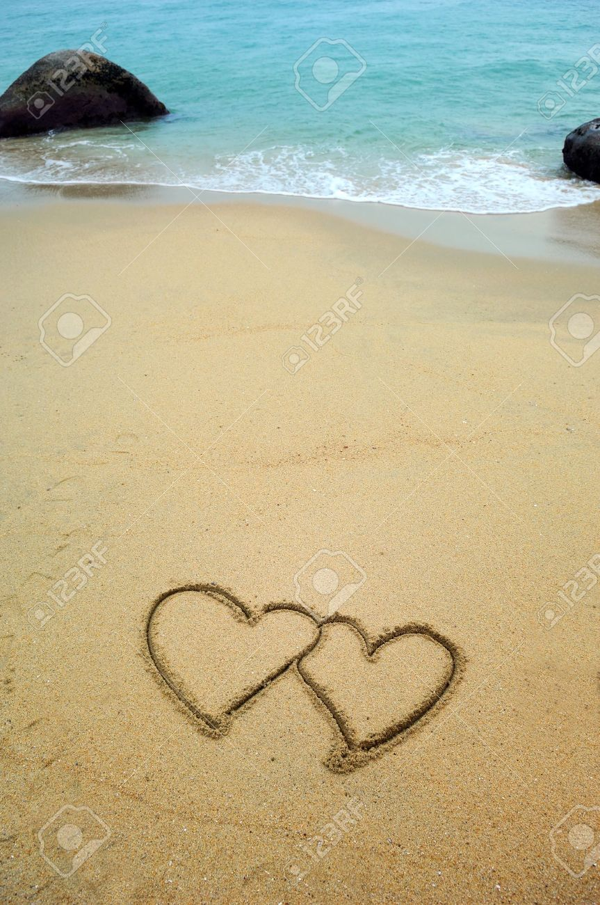 Two Hearts Drawn In Beach Sunset Stock Photo