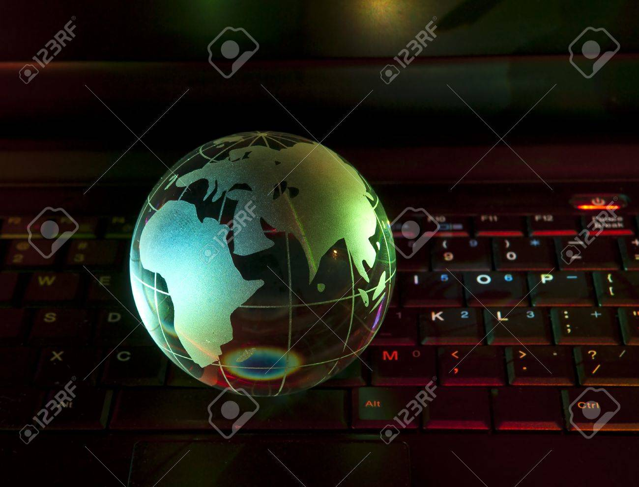 glass globe on a laptop keyboard Stock Photo - 8180425