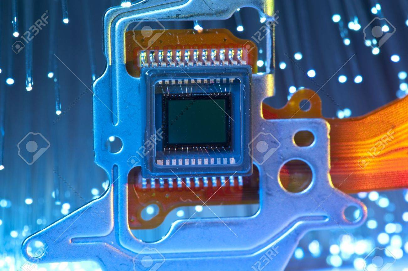 Ccd Sensor On A Card Of Digital Camera With Fiber Optical Background Optics Integrated Circuits Images Stock Photo 8414274
