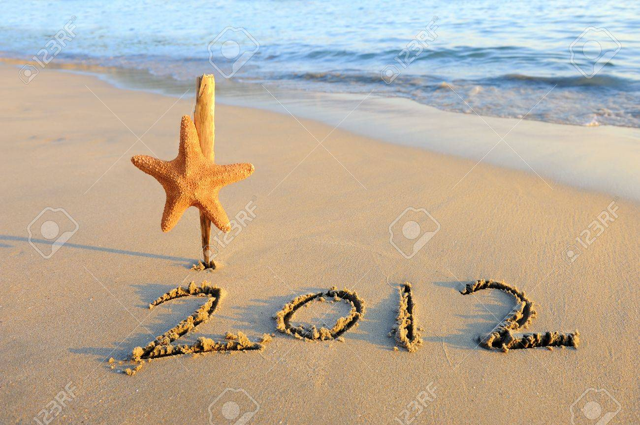 2012 new year message on the sand beach with starfish Stock Photo - 11884250