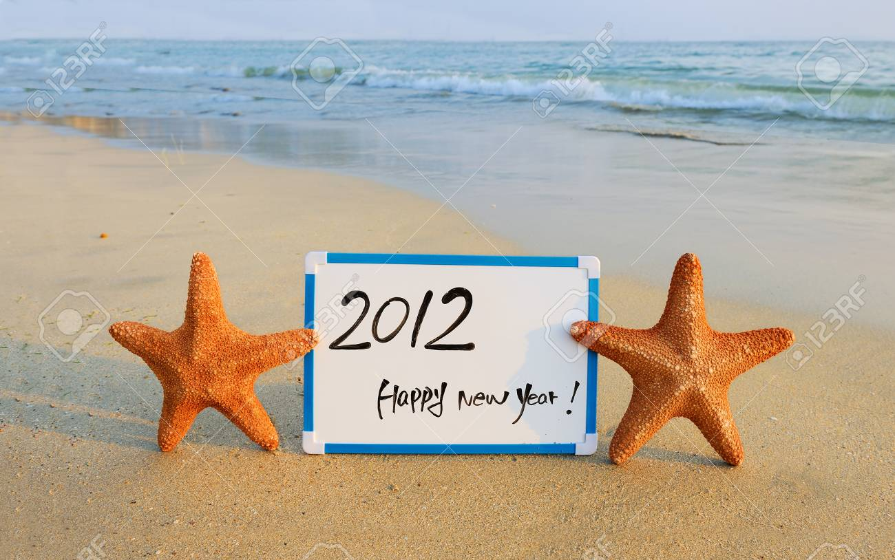 2012 happy new year message on the sand beach Stock Photo - 11871081