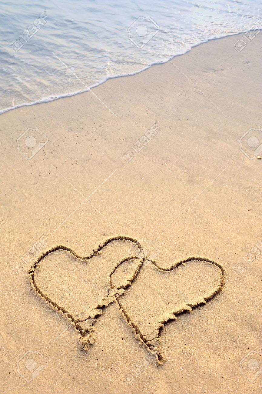two hearts drawn in beach Stock Photo - 11966238