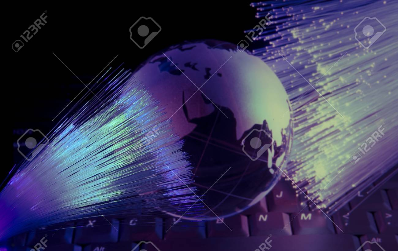 computer data concept with earth globe against fiber optic background Stock Photo - 12767832