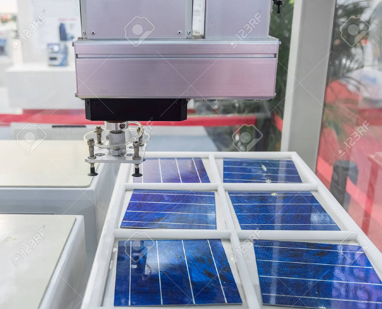production of solar panels, Industrial robot working in factory,Conveyor Tracking Controler of robotic hand. - 59453036