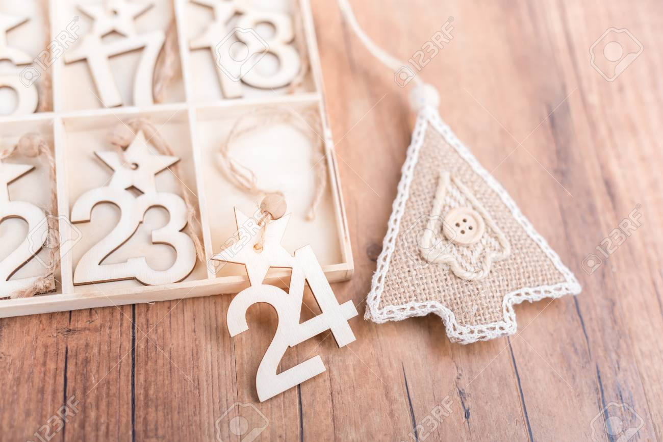 24 Days till Christmas vintage style wood calendar with festive tree on wooden background,Christmas eve time concept - 94188371