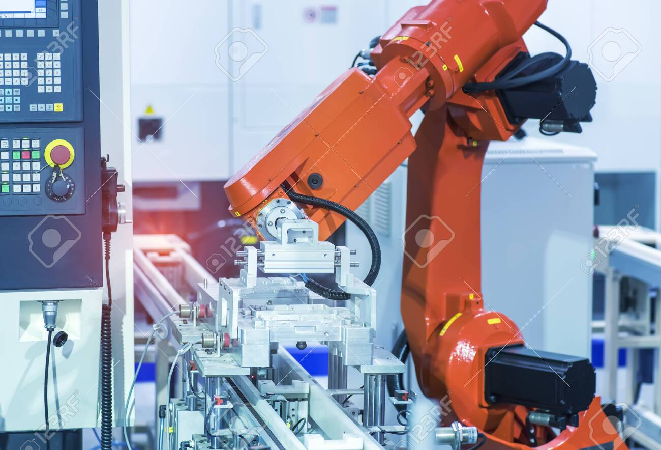 robot arm is working smartly in the production department in artificial intelligence factory - 128943543