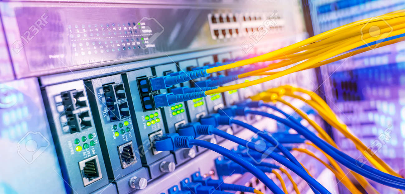 Fiber Optical cables connected to an optic ports and Network cables connected to ethernet ports - 167078315