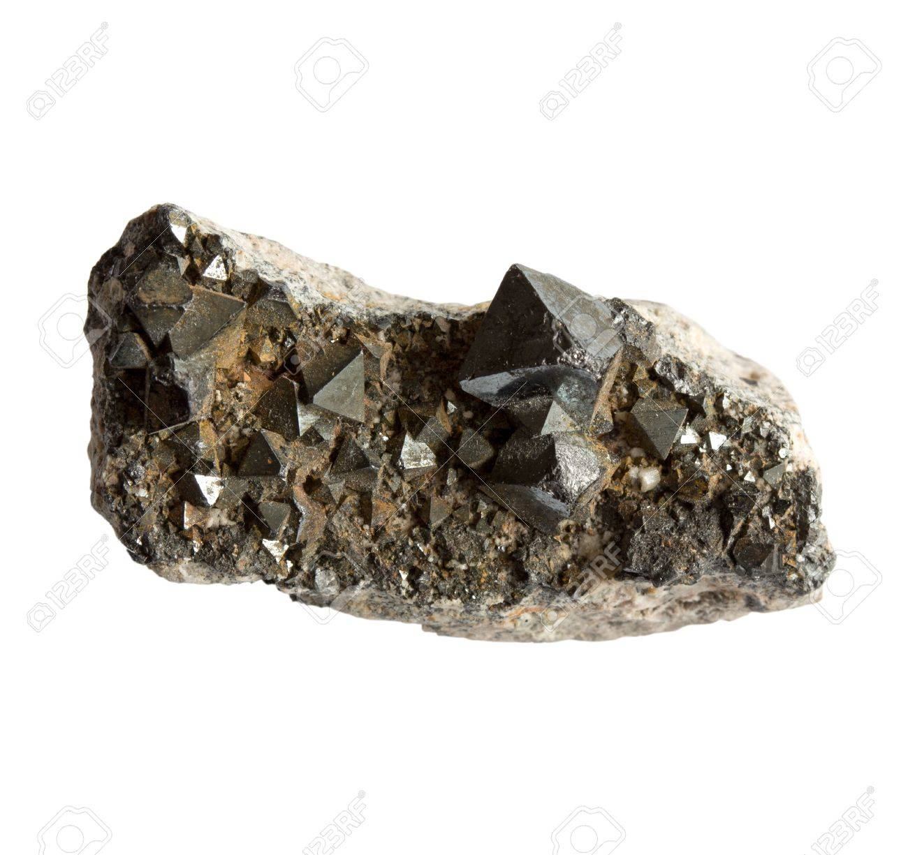 Magnetite crystals in the stone on a white background - 21249818