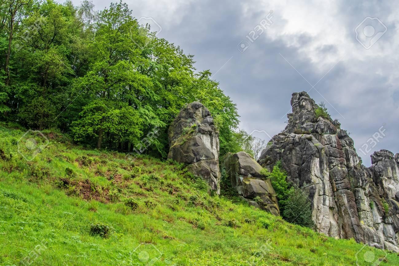 Sandstone rock formation Externsteine in Teutoburg Forest, Germany . - 117911943