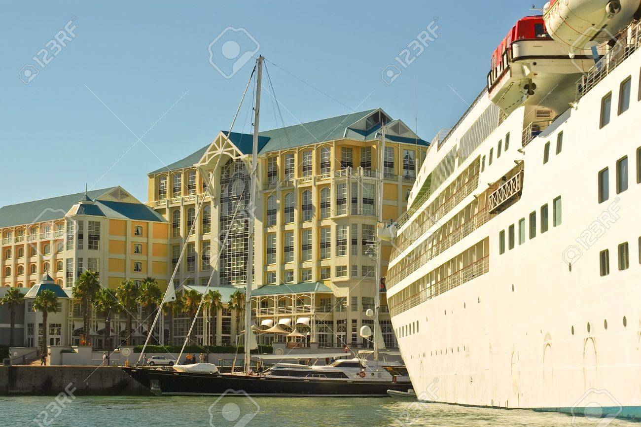 first-rater yacht near luxury ocean passenger cruise liner near hotel in the bay of cape town, south africa Stock Photo - 3077267