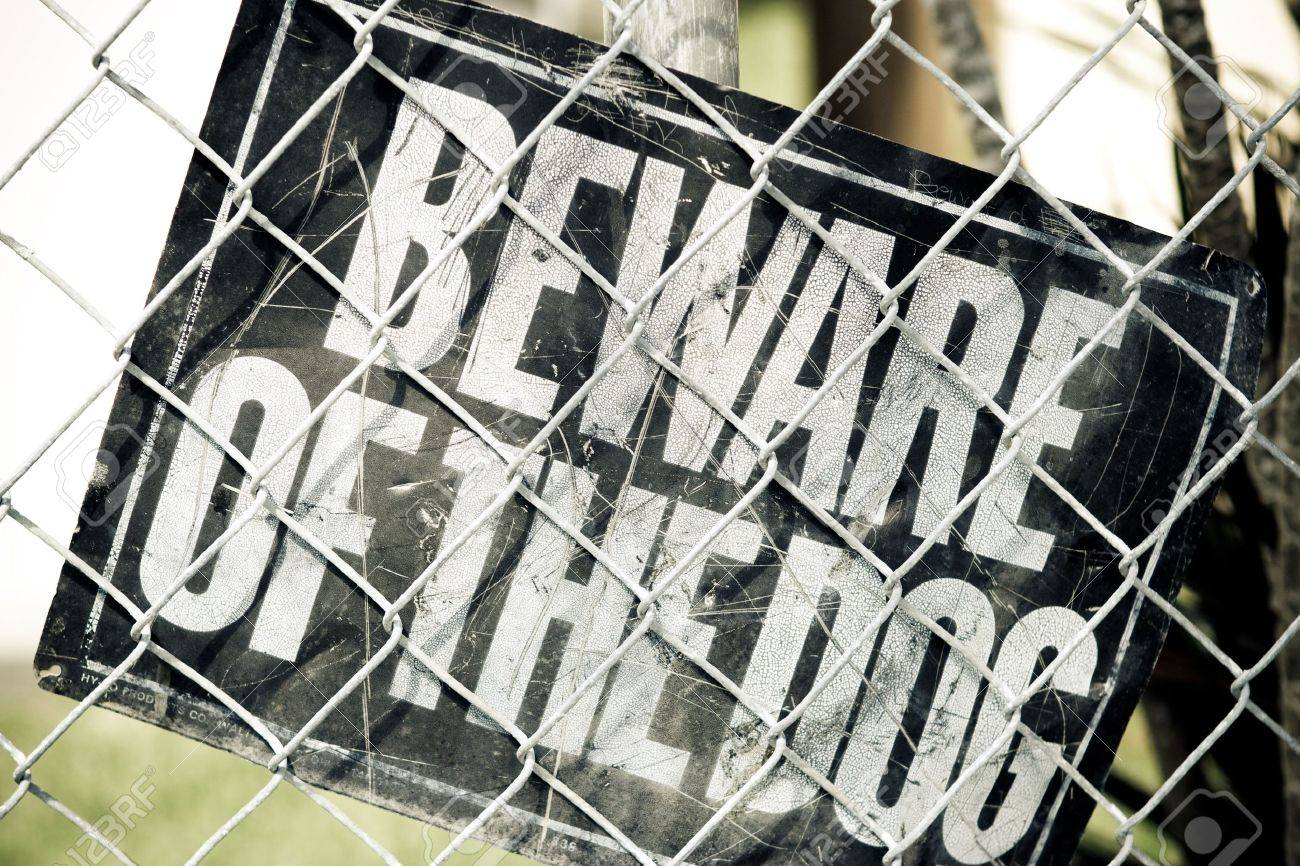 Beware of the Dog Sign inside a fenced urban area Stock Photo - 5415934