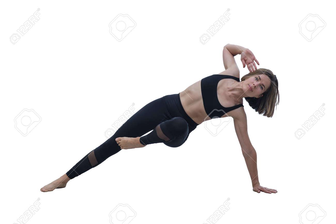 Young slim beautiful woman practicing yoga, exercising, making yoga pose, isolated on the white background - 171536457