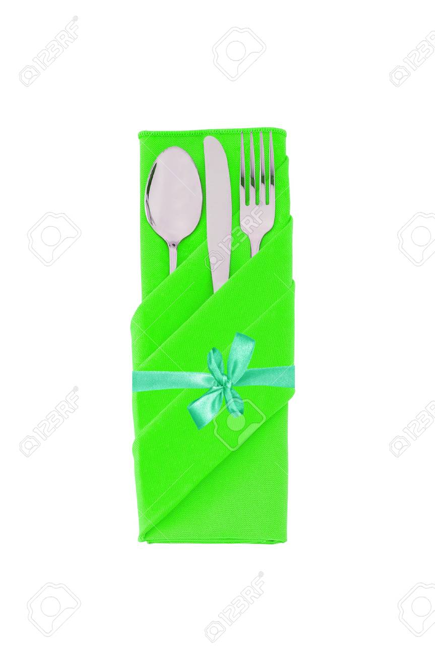 Fork, spoon and knife in green cloth with bow isolated on white background Stock Photo - 15898711