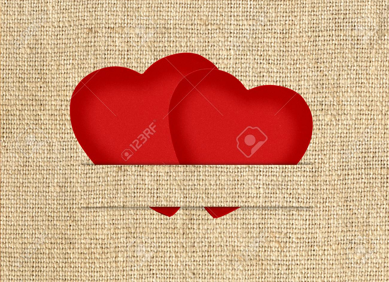 Vintage Valentine Card In The Form Of Red Paper Hearts On A Fabric