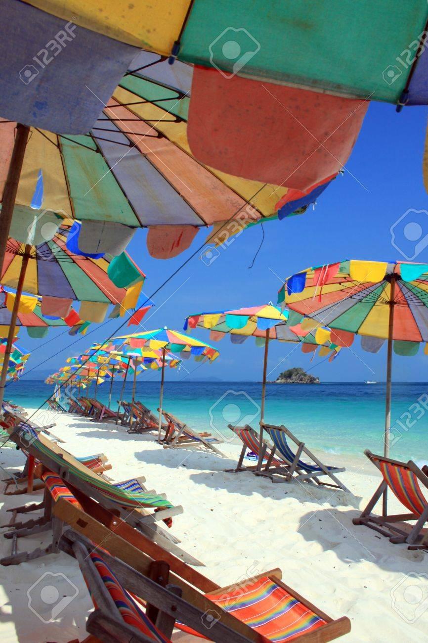 Beach chair and colorful umbrella on the beach , Phuket Thailand Stock Photo - 9680872