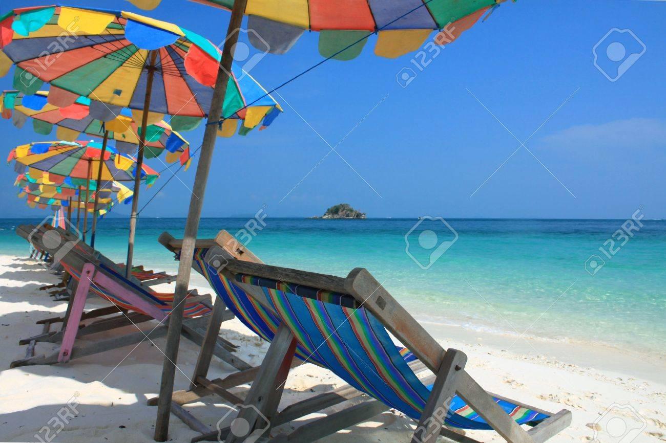 Beach chair and colorful umbrella on the beach , Phuket Thailand Stock Photo - 9680875