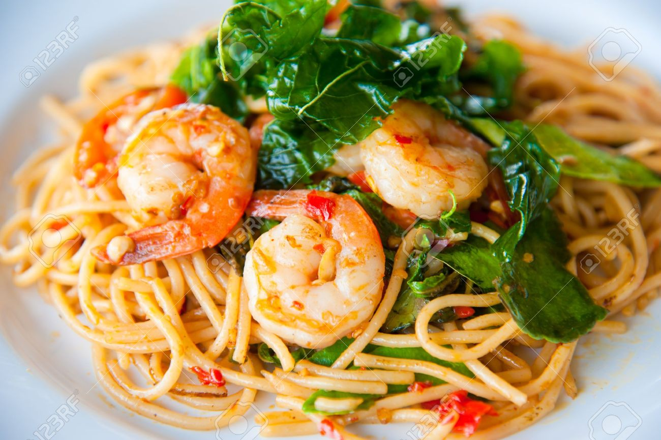tasty hot and spicy spaghetti with cream, cheese and parsley close up Stock Photo - 10101406