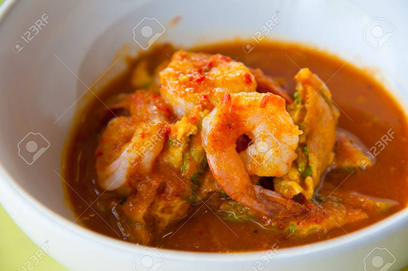 hot and sour curry with tamarind sauce, shrimp and vegetables : Delicious thai traditional food (kang som cha-om koong) Stock Photo - 10280593
