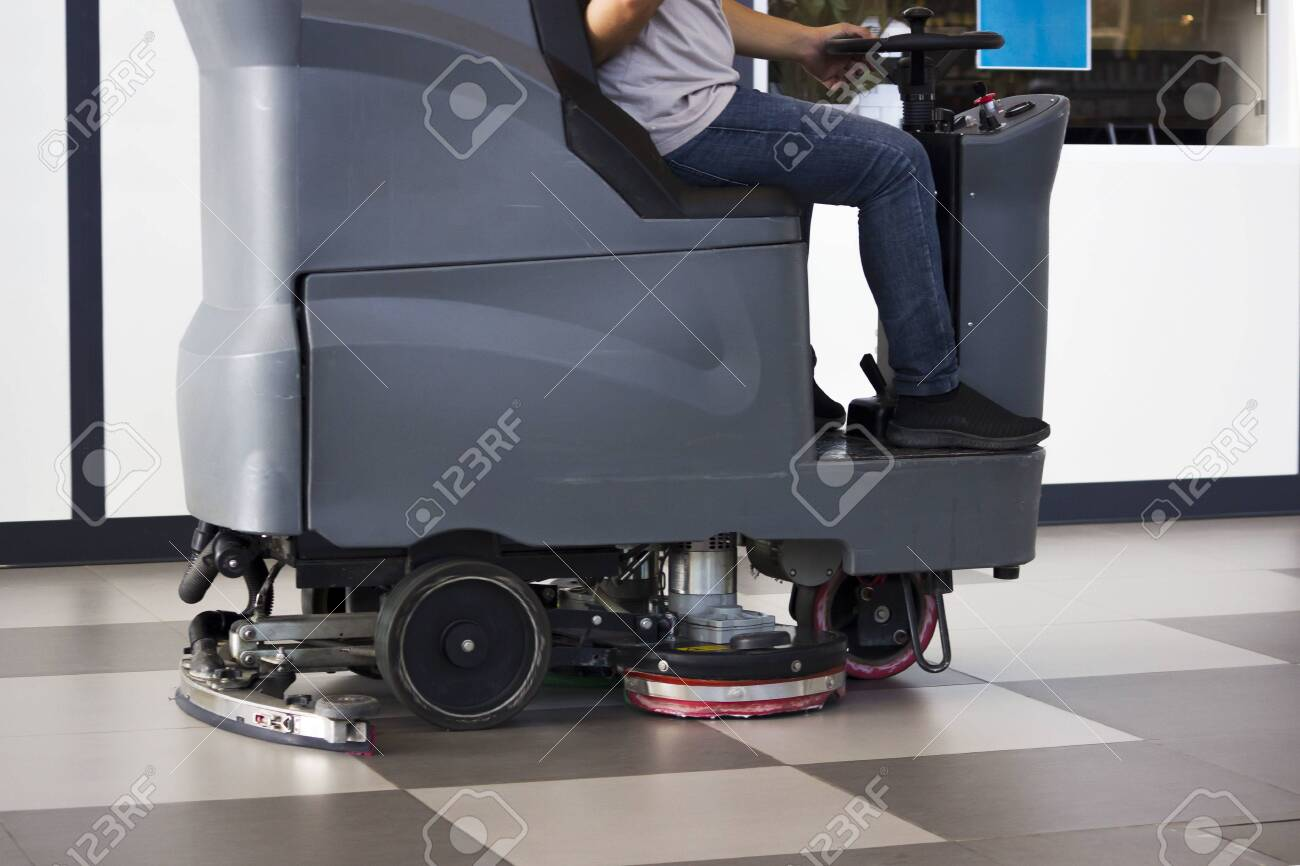 Brush in the battery scrubber-dryer in Russian airport. - 142799331