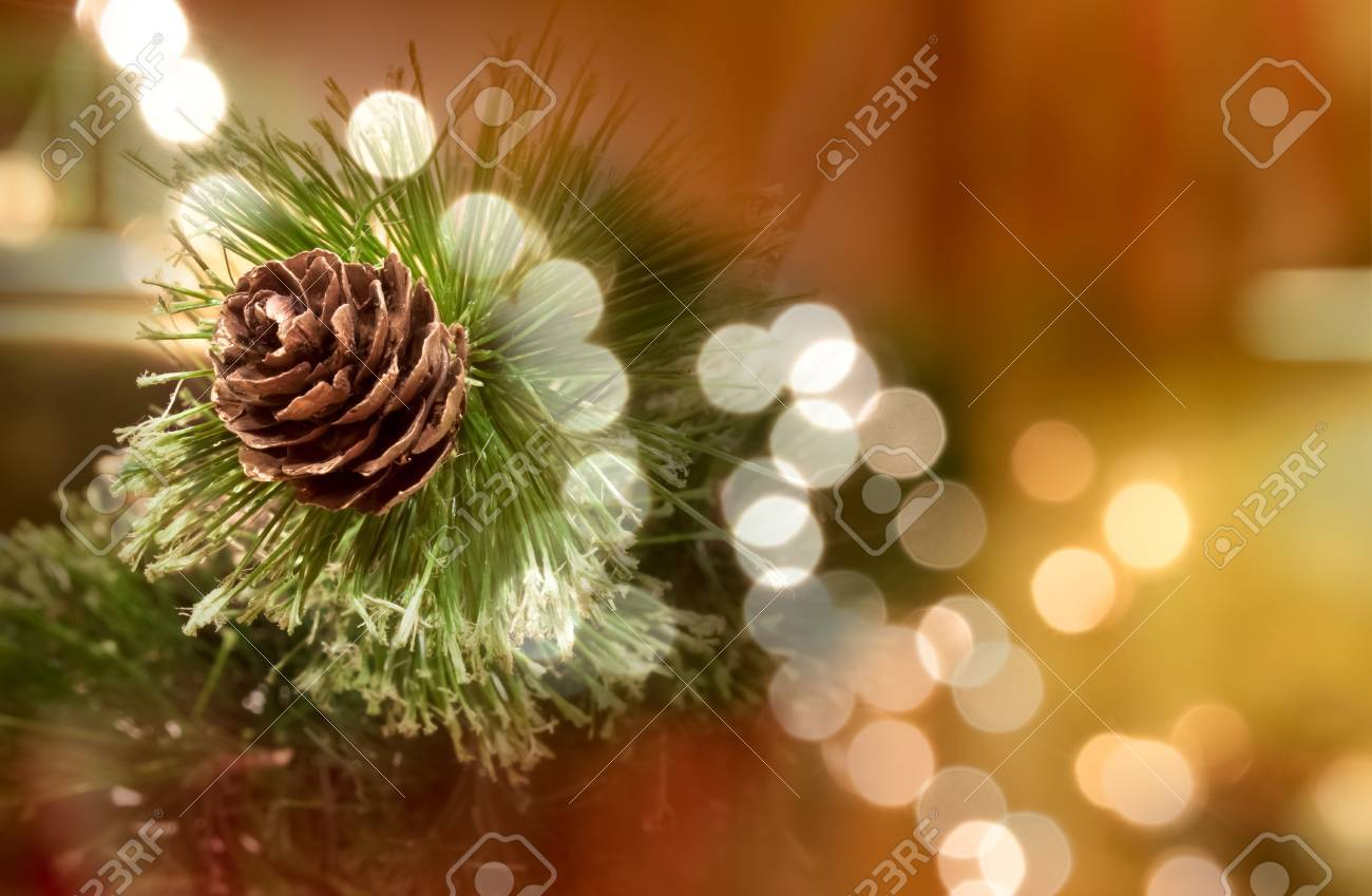 decorative pine cone, a fake oune tieh some fake needles as a table top centerpiece decoration Stock Photo - 8521932