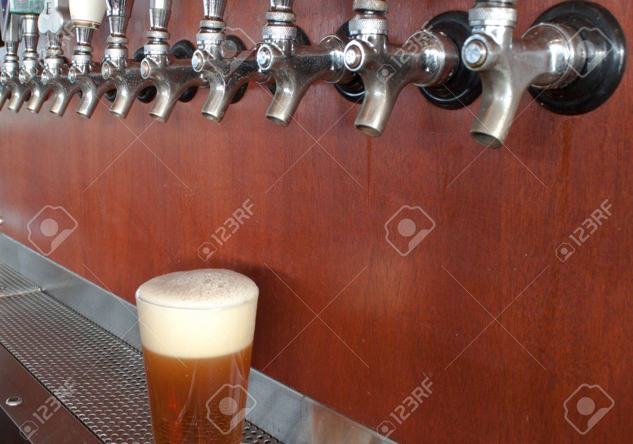 beer taps in a bar with wood in the background Stock Photo - 11536324
