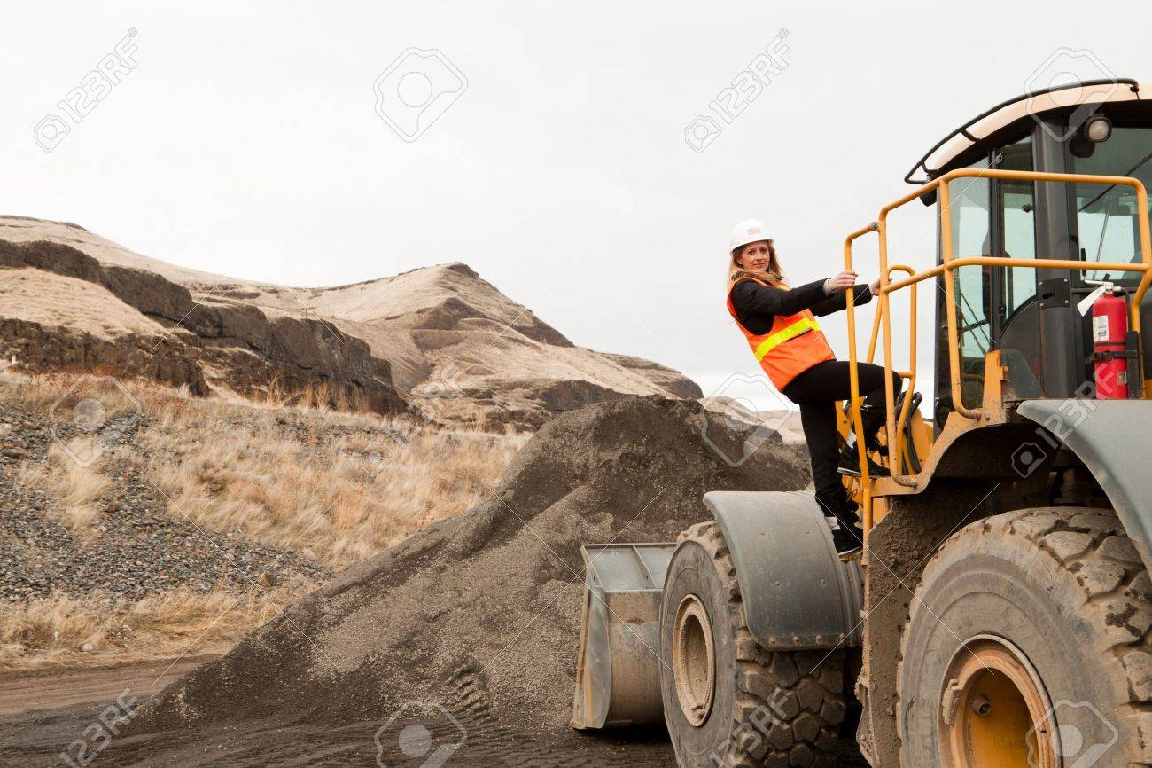 female construction worker with a front loader machine Stock Photo - 12228474