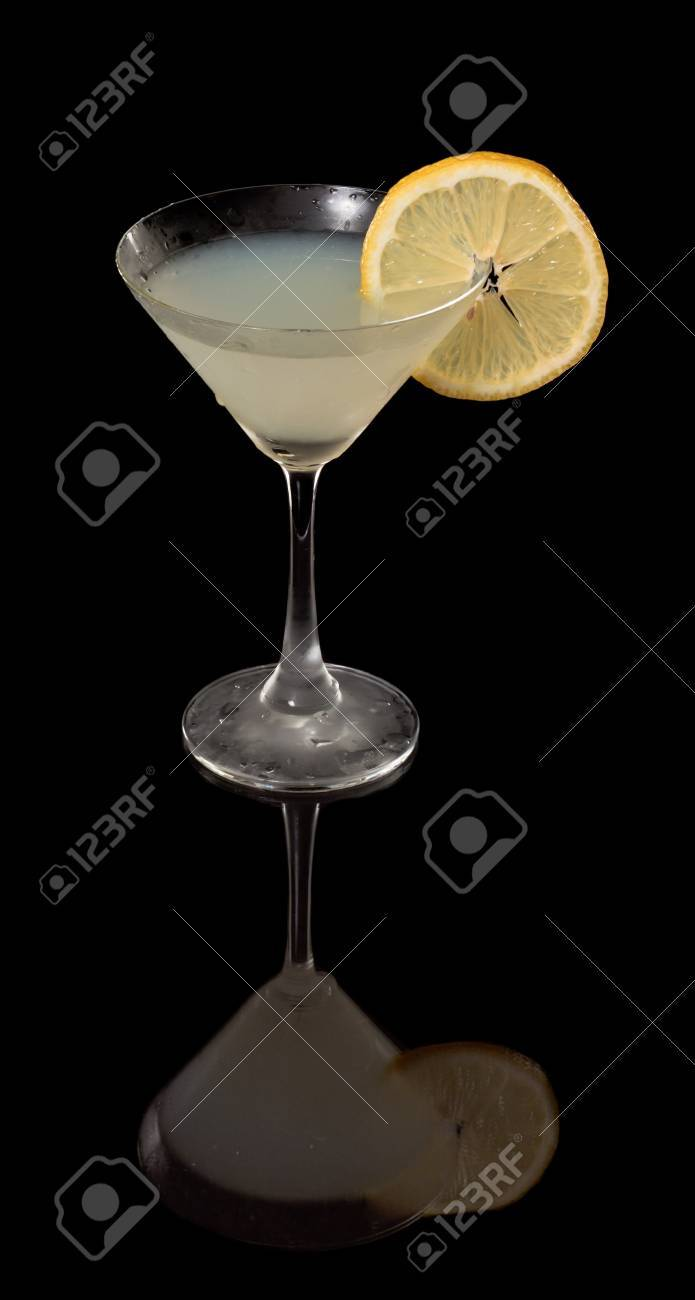 isolated lemon drop martini on a black background garnished with a lemon wheel with full reflection Stock Photo - 12499115