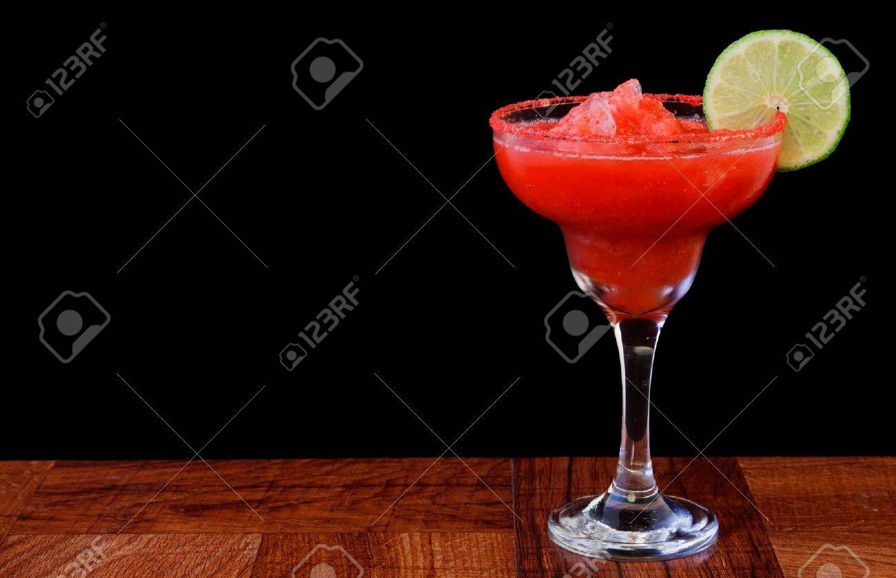 strawberry margarita isolated on a black background served on a bar top Stock Photo - 13030746