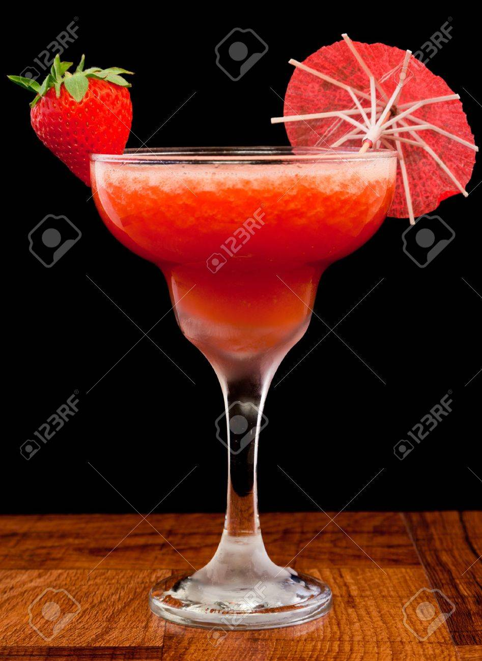 fresh pureed strawberry margarita isolated on a black background Stock Photo - 13030755