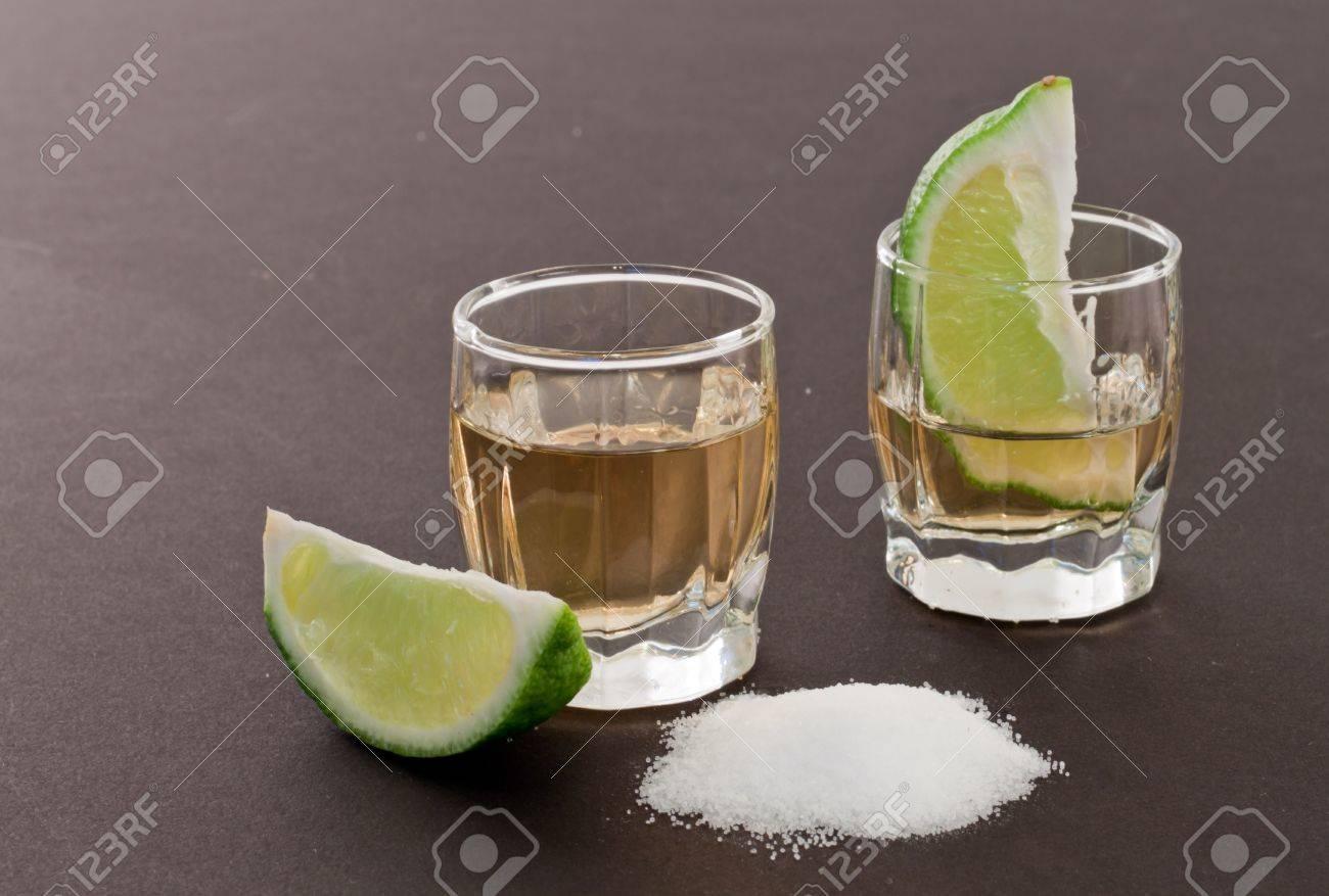 bar top with shot glass garnish with limeand salt Stock Photo - 13524459