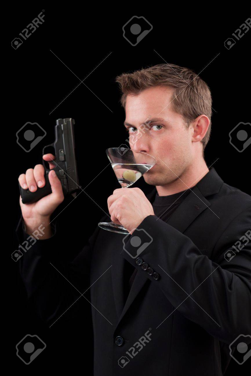 caucasian male model holding a gun isolated on a black background Stock Photo - 13991347
