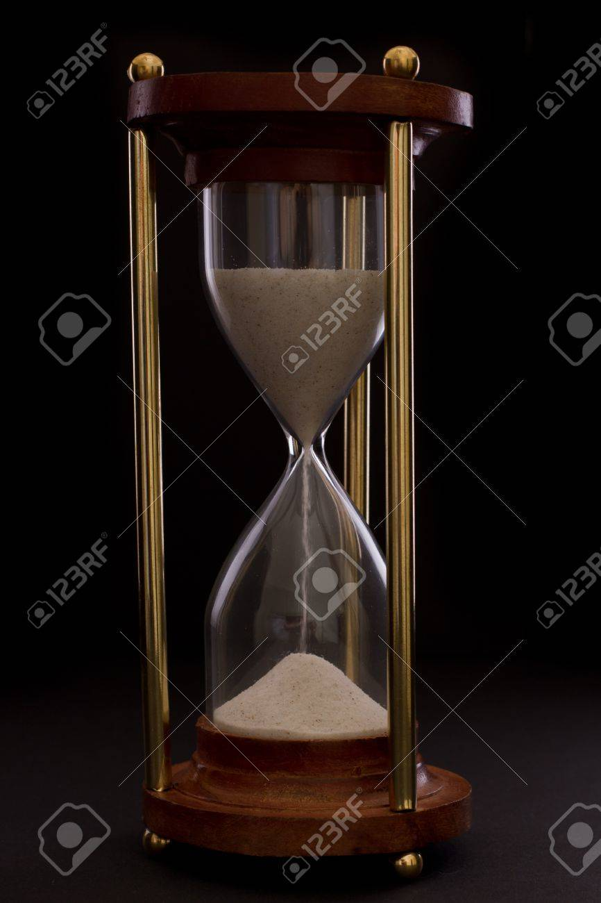 hourglass on a dark setting, concept of time passing Stock Photo - 17445890