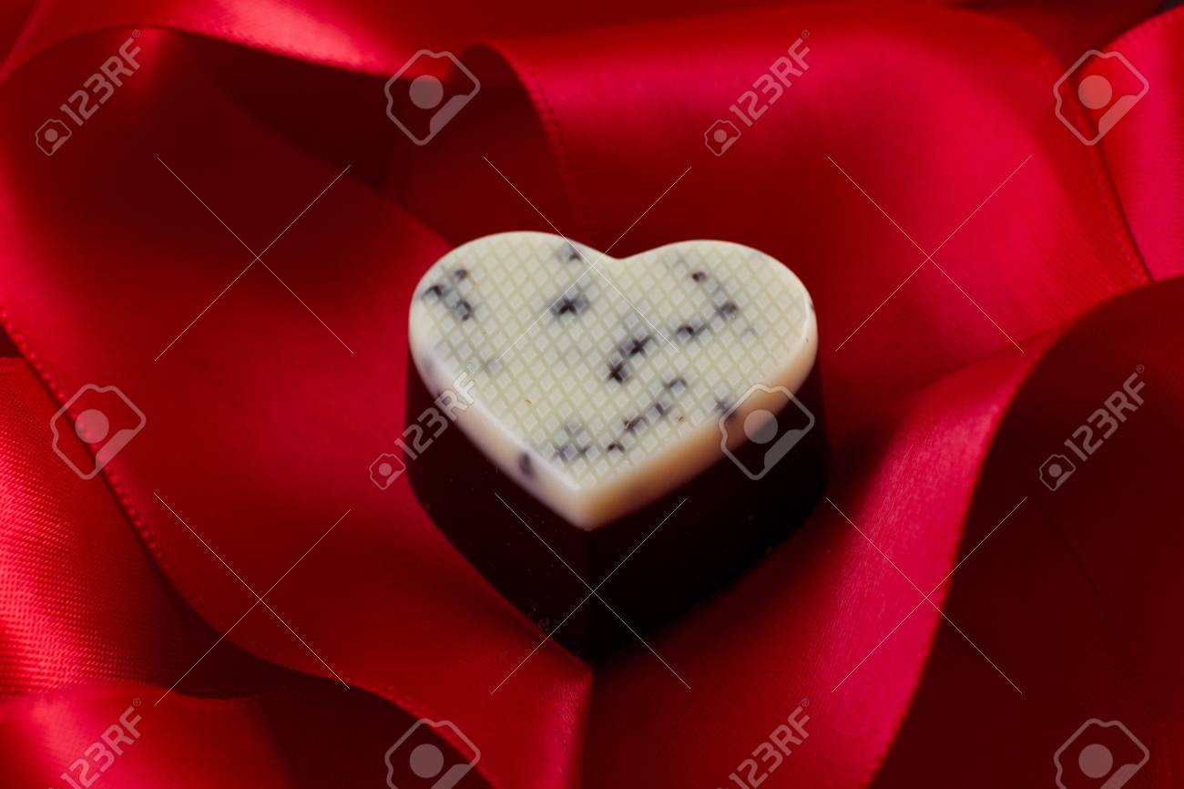 dark chocolate with cream and cocoa nibs on a red silk Stock Photo - 17445906