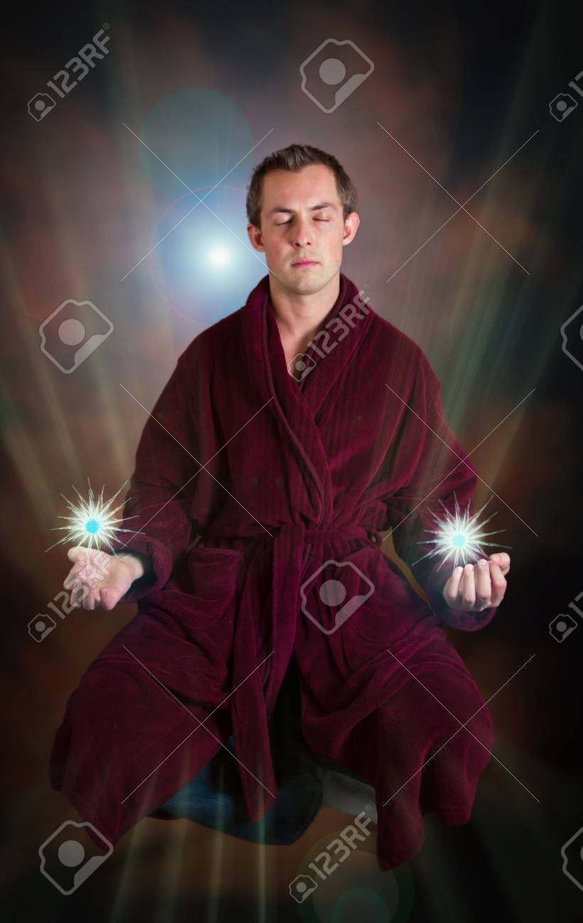 young man levitating with energy in each hand Stock Photo - 17567019