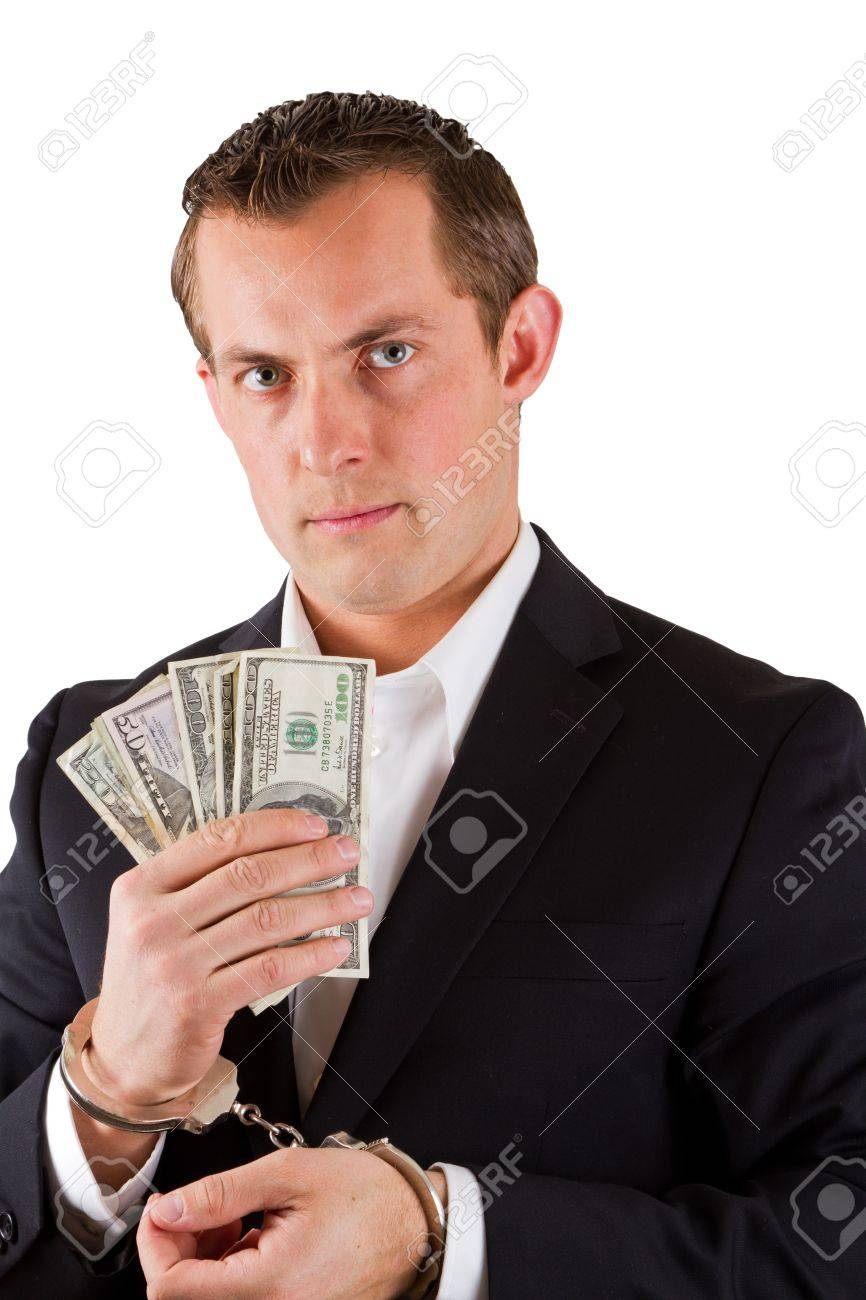 arrested businessman holding hundred dollar bills isolated on a white background Stock Photo - 17799703
