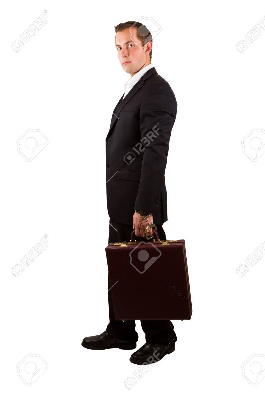 closeup of a businessman holding a briefcase with handcuffs isolated on a white background Stock Photo - 17799681