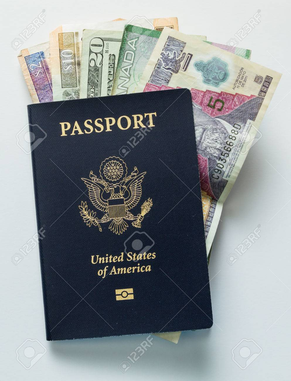 Close Up An American Passport With Money Form Different Countries ...