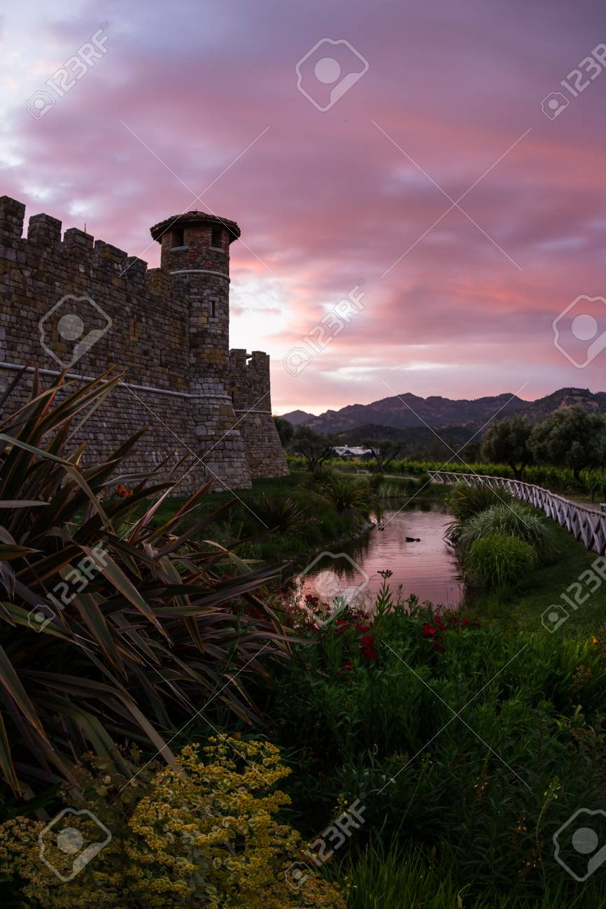 Castle In Napa Valley At Sunset With A Reflection On The Mote Stock