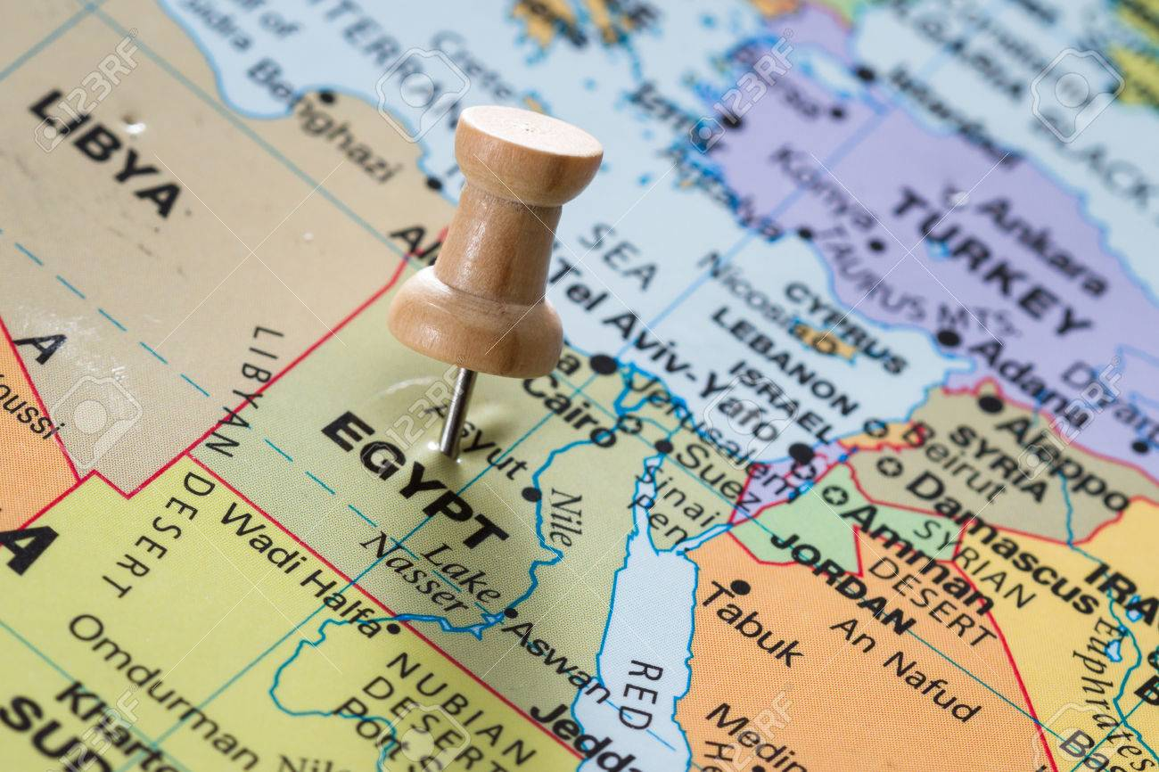 close up of the word Egypt on a world map marked with a push