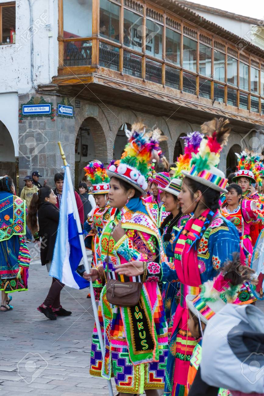 Cusco, Peru - May 13: Native people of Cusco dressed in colorful