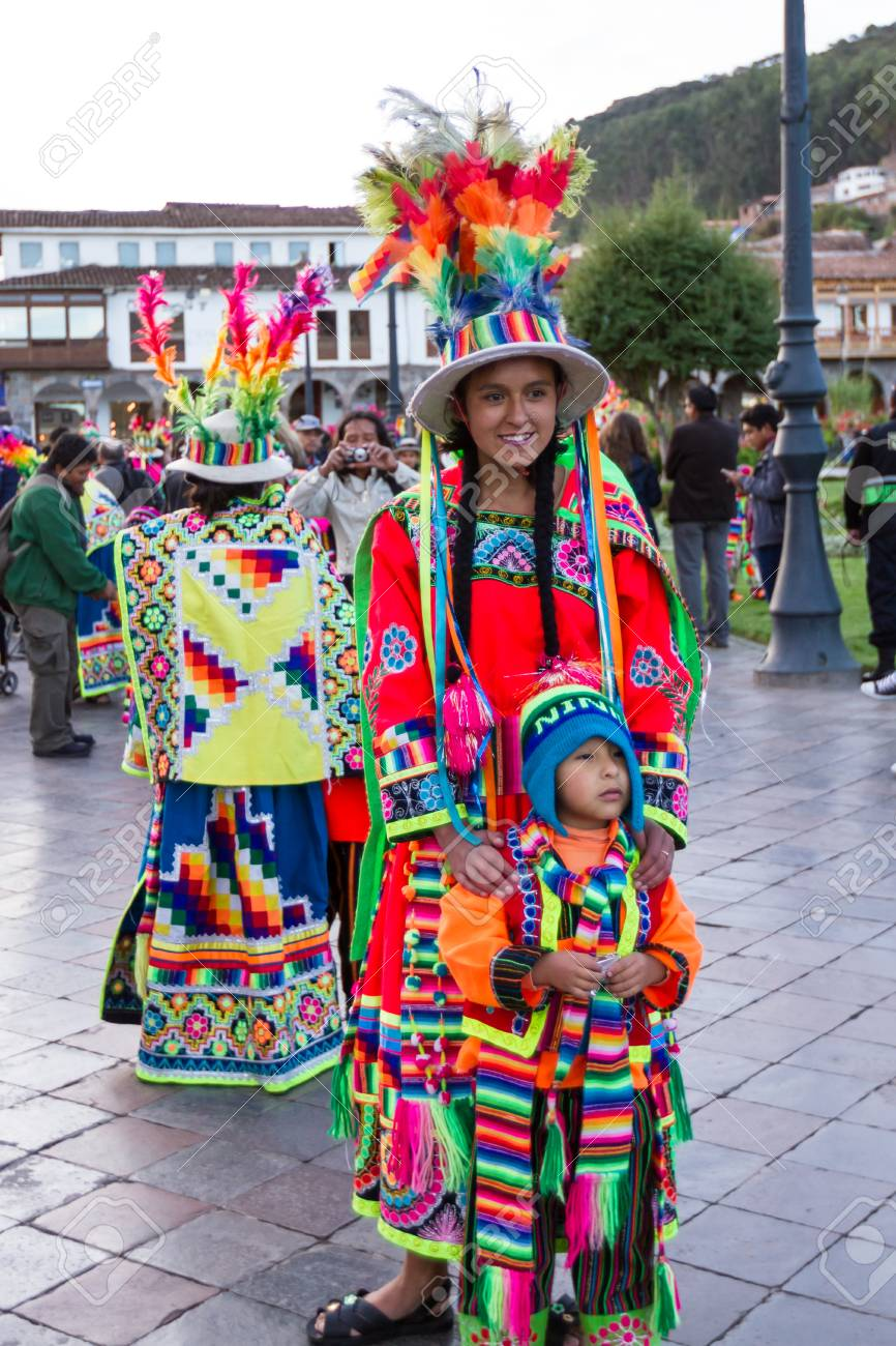 Cusco, Peru - May 13: young mother posing with her child dressed