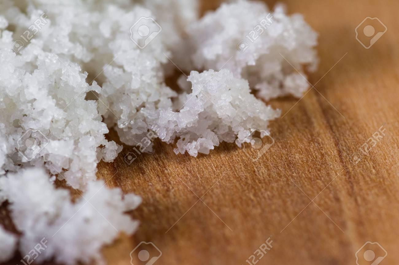 Celtic sea salt piled on a wooden cutting board