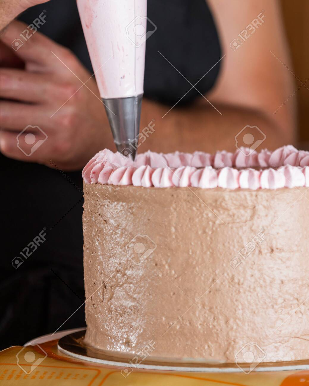 Prime Close Up Of A Chefs Hands Decorating A Birthday Cake With A Funny Birthday Cards Online Overcheapnameinfo
