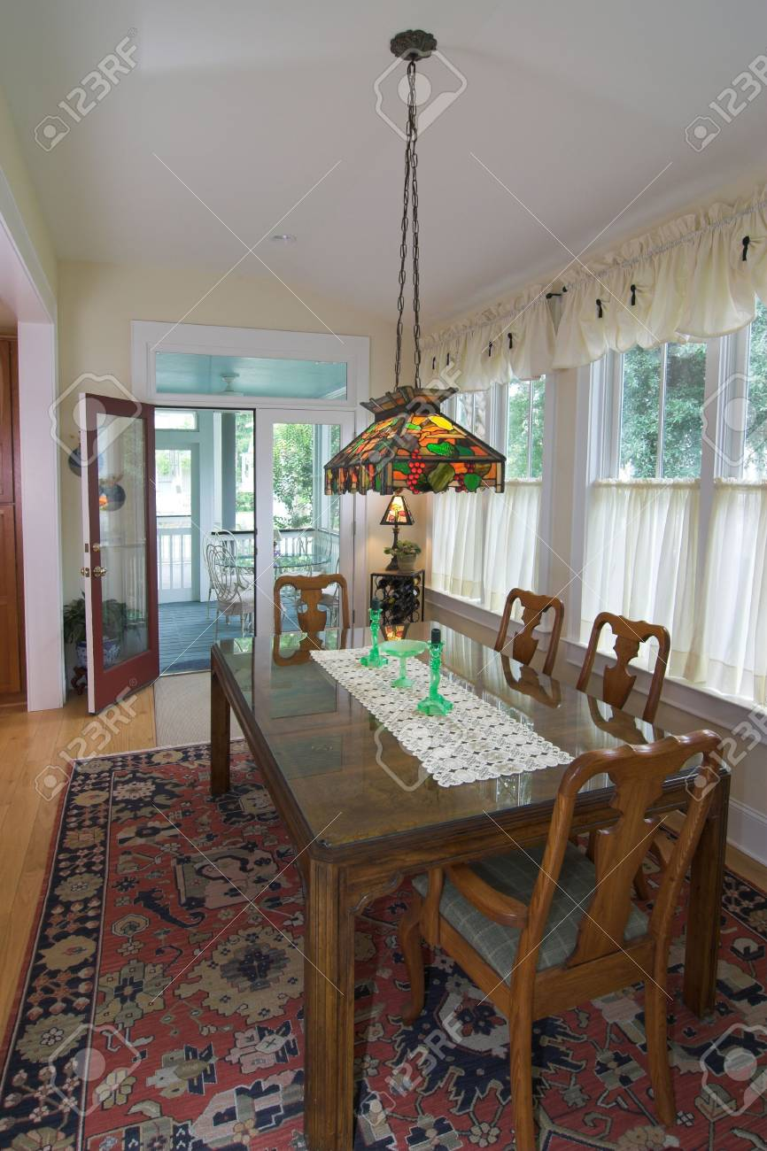 Elegant Diningroom With Colored Glass Chandelier Stock Photo   2175801