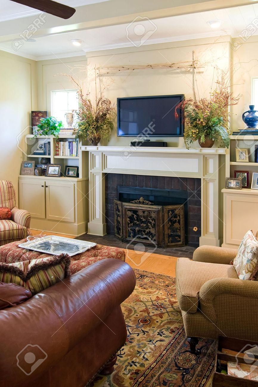 Elegant Living Room With Fireplace And Plasma Tv Stock Photo