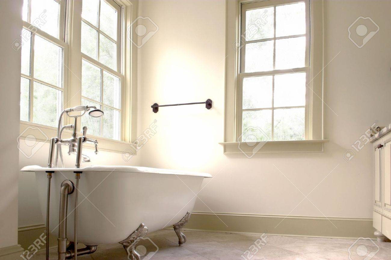 Simple White Bathroom With Clawfoot Tub