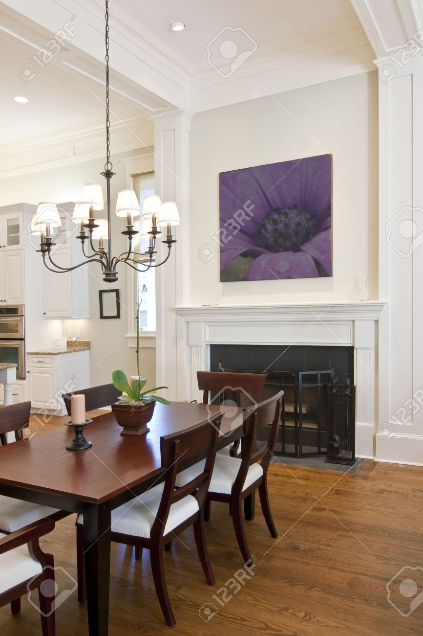 beautiful diningroom with fireplace looking out to kitchen Stock Photo - 4255465